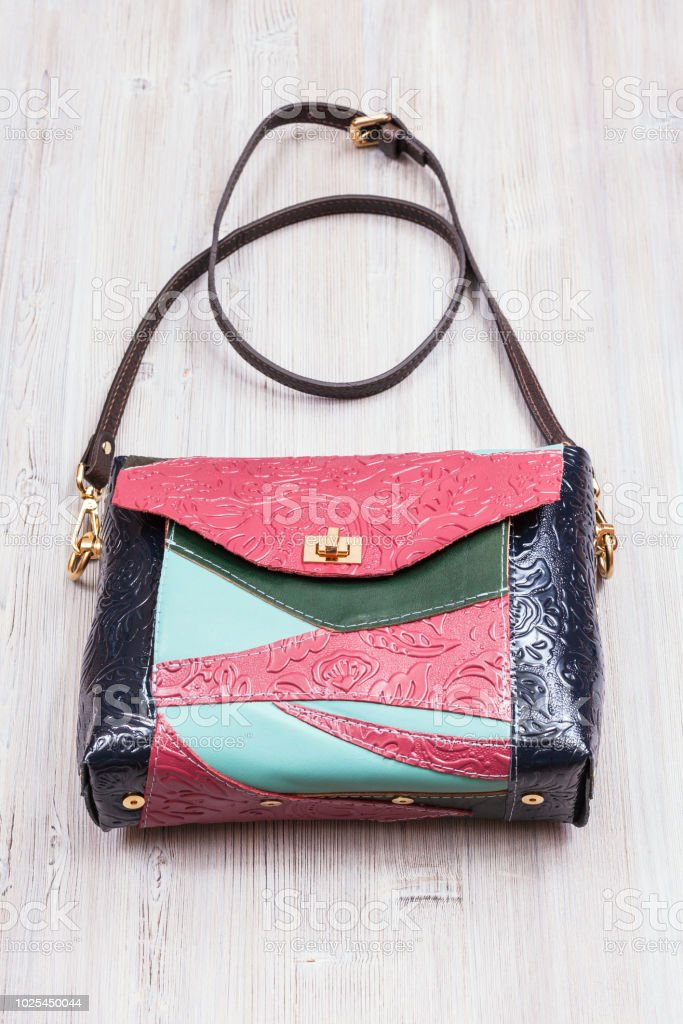 071da508cb0f patchwork leather evening bag on gray table royalty-free stock photo
