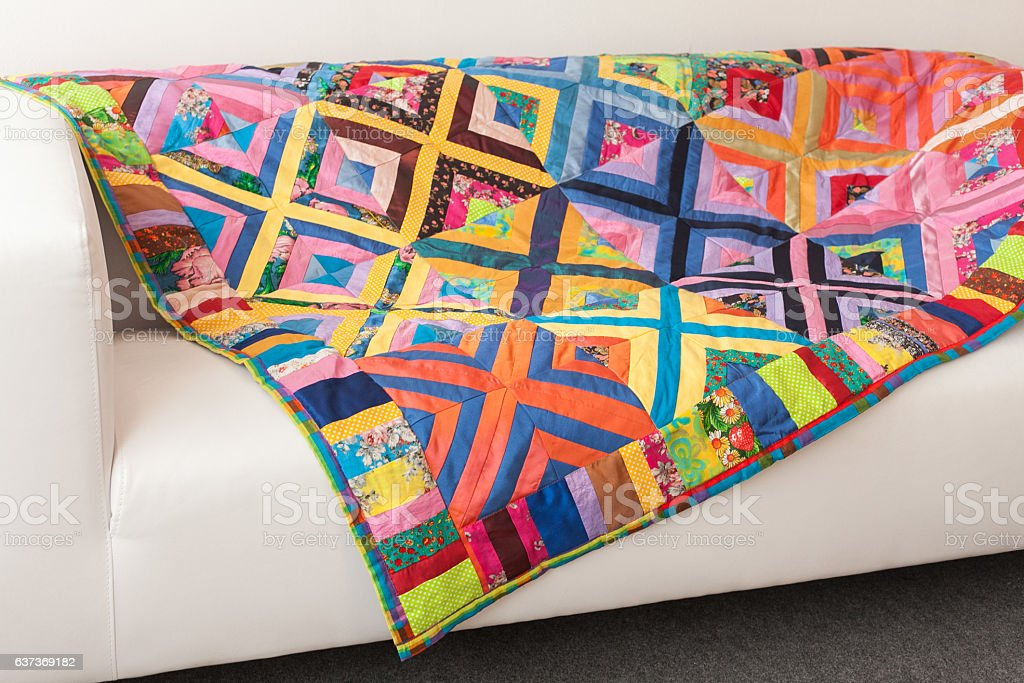 Patchwork quilt. Part of blanket as background. stock photo