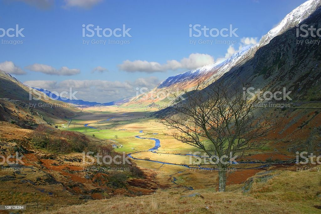 Patchy sunshine through Snowdonia landscape stock photo