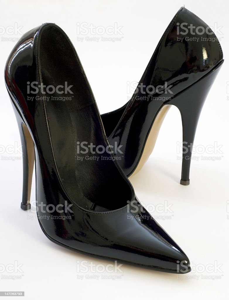 Patent black stiletto court shoes on a white background royalty-free stock photo