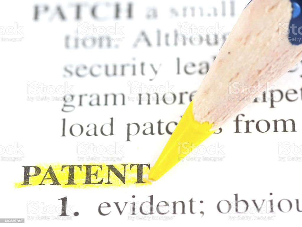 patent definition marked in dictionary stock photo