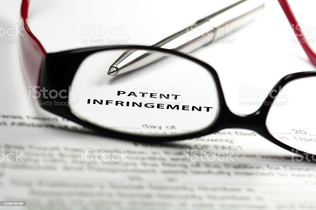 Patent infringement stock photo