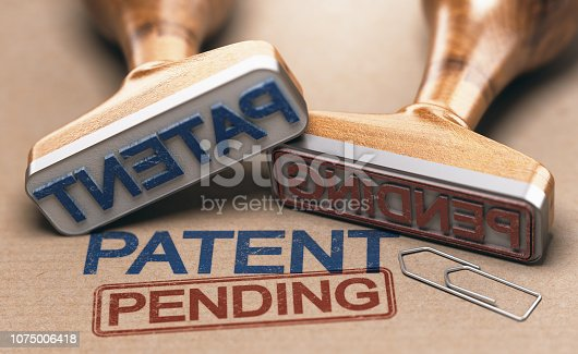 Two rubber stamps with the words patent and pending over brown paper background. Intellectual property concept. 3D illustration.