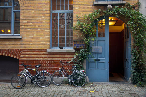 Patershol district in Ghent Horizontal view of three bicycles parked at the entrance to the Aqua Azul Sauna in Patershol district, Ghent spa belgium stock pictures, royalty-free photos & images