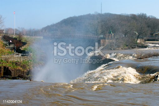 The Great Falls of the Passaic River is a waterfall in the city of Paterson, New Jersey, USA. Mist and rainbows abound at the waterfall after a day of heavy rains.