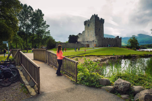 Path and footbridge leading to Ross Castle in Ireland stock photo