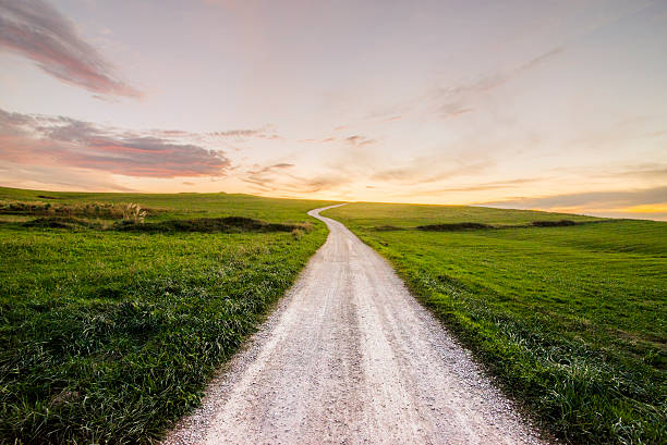 path at sunset - footpath stock photos and pictures