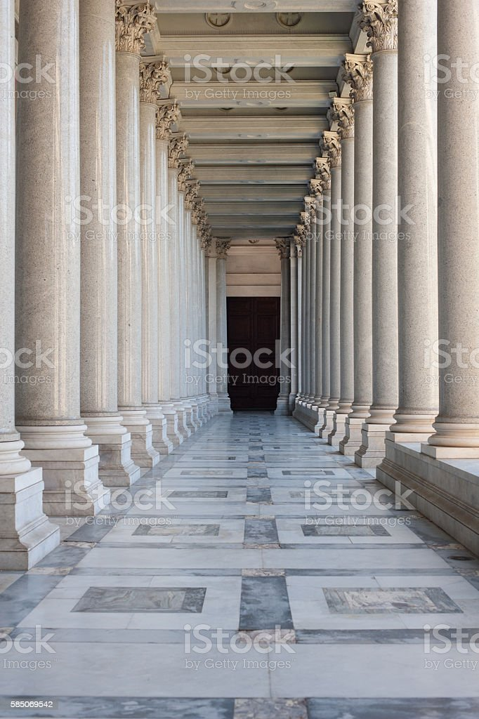 Path between colonnade, symbol of unknown and mystery stock photo