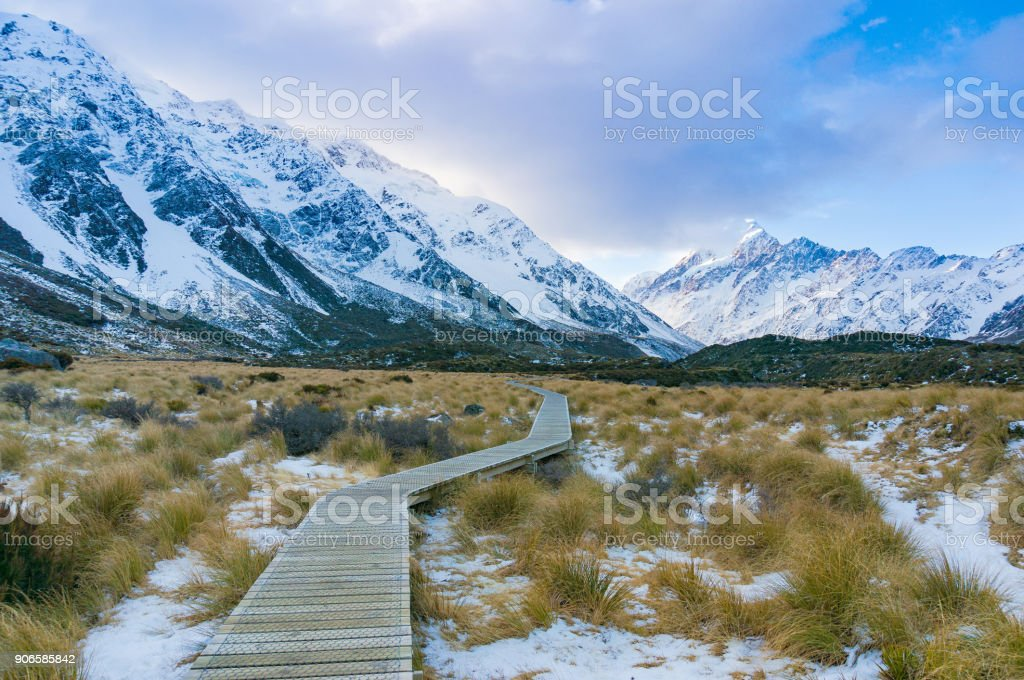 Path in mountain valley in winter stock photo