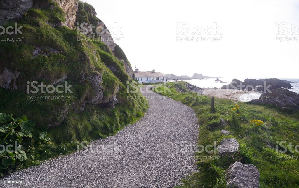 Path leading to houses in Ballintoy Harbour stock photo