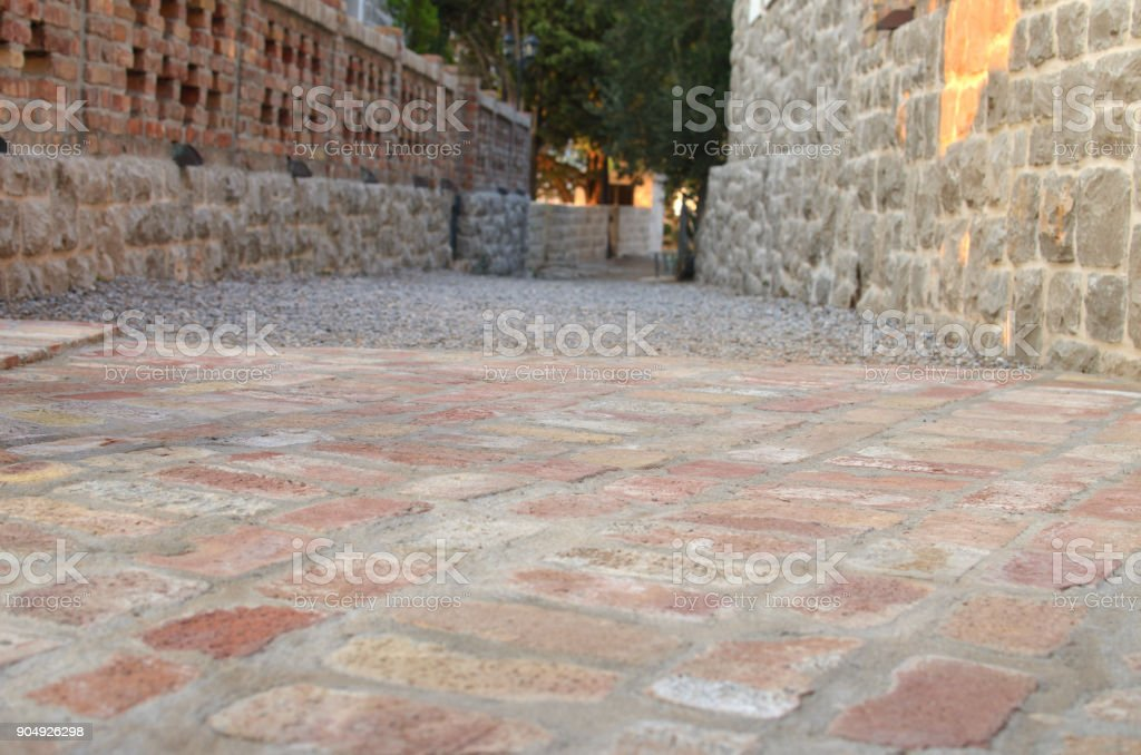 Path made of bricks and cobblestones stock photo