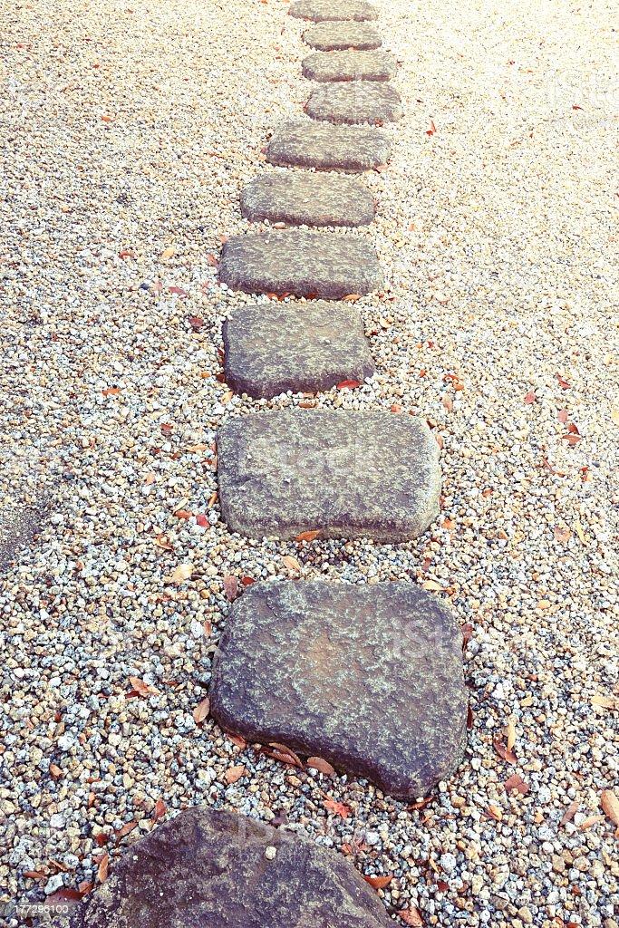 Path of flat square stones across gravel royalty-free stock photo