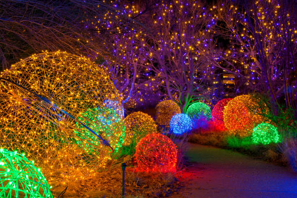 Path of Lights - A night view of a winding path lit by colorful lights at Denver Botanic Gardens during its holiday Blossoms of Light event. Denver, Colorado, USA. stock photo