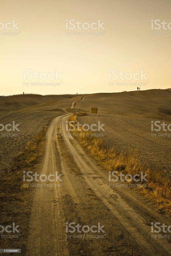 Path on Tuscan hills in summer twilight royalty-free stock photo