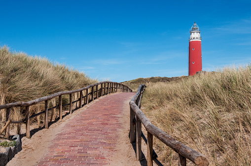 path over the dunes to the lighthouse in Texel