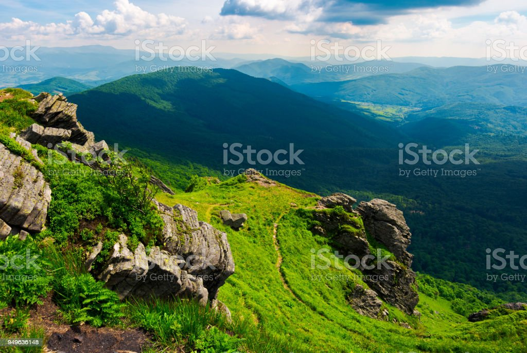 path to a tiger face cliff above the valley stock photo