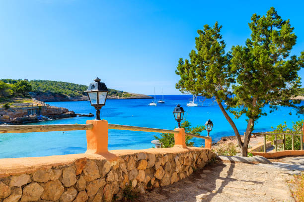 Path to beach in Cala Portinatx bay, Ibiza island, Spain Ibiza is an island in the Mediterranean Sea off the east coast of Spain. It is the third largest of the Balearic Islands. sailing dinghy stock pictures, royalty-free photos & images