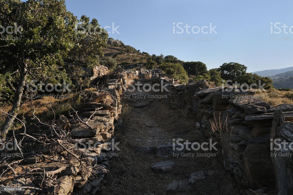 Path to cave Foros.Andros island. Cyclades Greece. stock photo