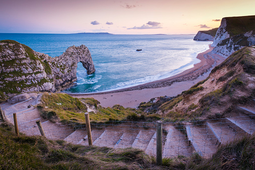 Path to ocean beach cove cliffs Durdle Door Dorset UK