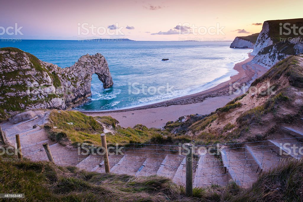 Path to ocean beach cove cliffs Durdle Door Dorset UK stock photo