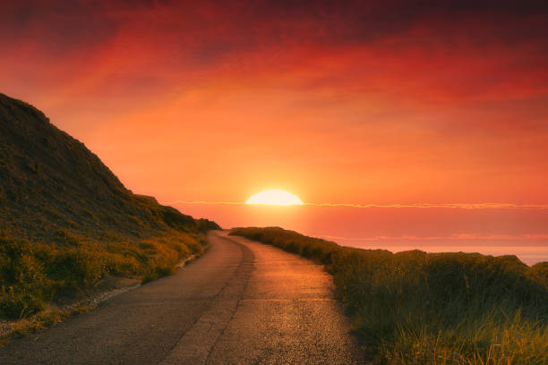 path to the sun at red sunset stock photo