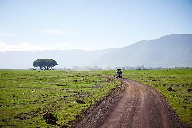 Path with 4x4 in the Ngorongoro crater. stock photo