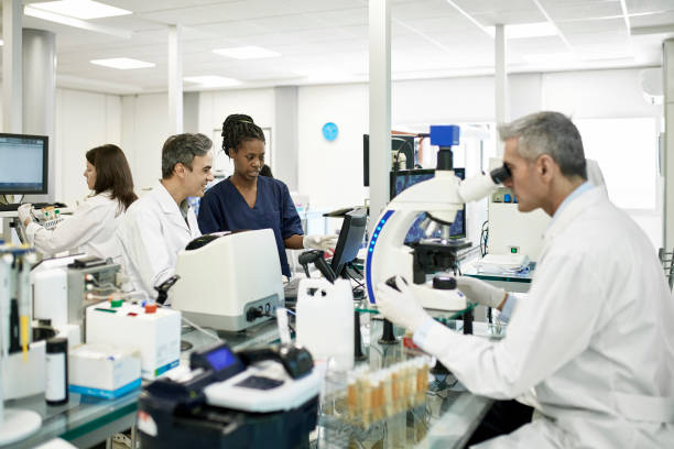 Pathologists and Technician at Work in Argentine Clinical Lab stock photo