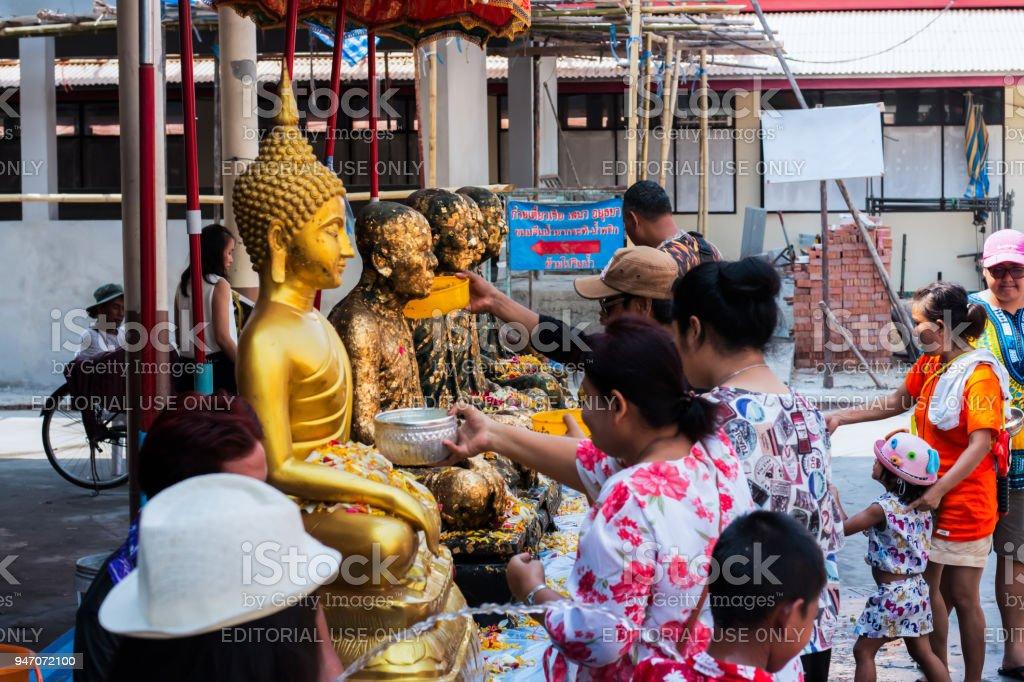 Pathum Thani,Wạd makham/Thailand- April 15 2018:  People are take a bath Buddha statue. Songkran Festival stock photo