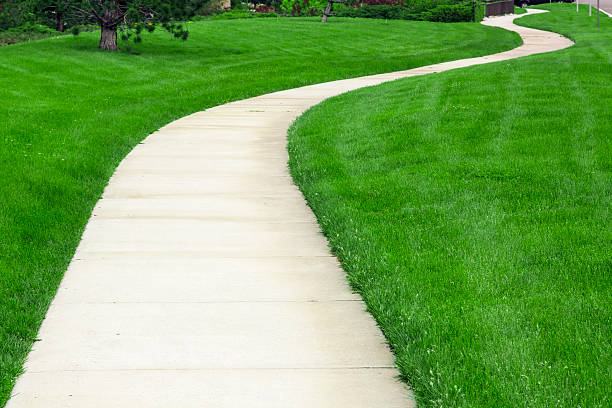 pathway - sidewalk stock pictures, royalty-free photos & images