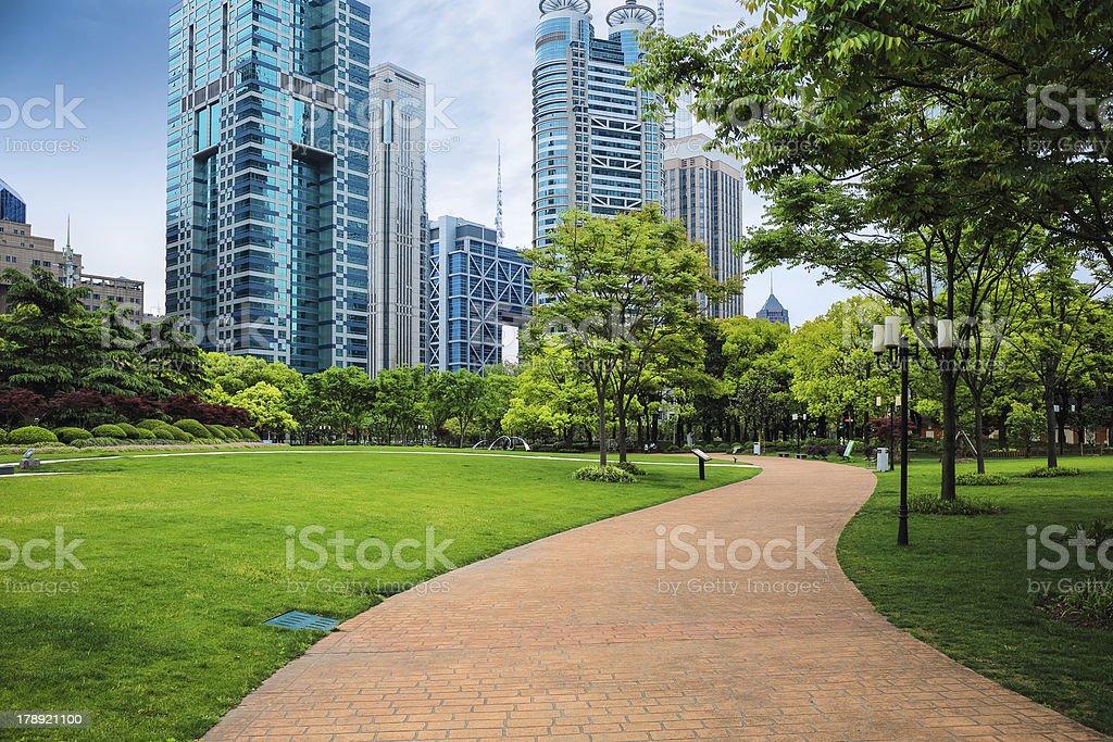 pathway through a green city park stock photo