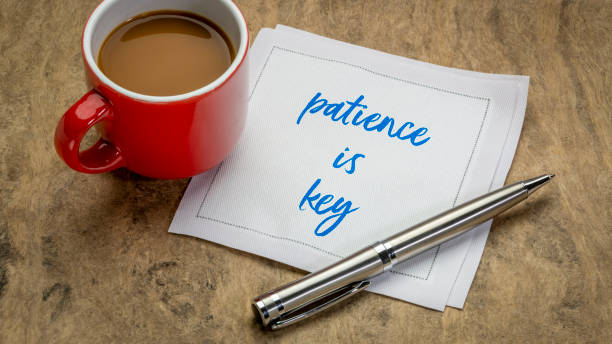 patience is key inspiraitonal note stock photo