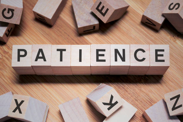 Patience Word In Wooden Cube Patience Word In Wooden Cube patience stock pictures, royalty-free photos & images