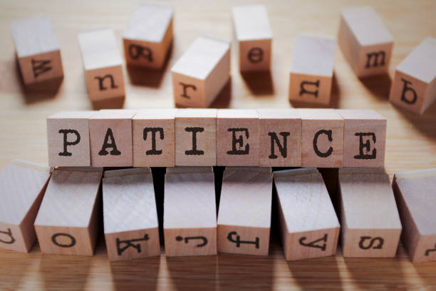 Patience Word In Wooden Cube stock photo