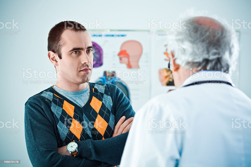 Patient and a male doctor stock photo