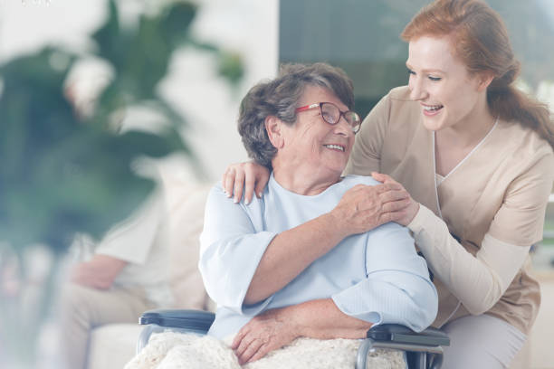 Patient and caregiver spend time together stock photo