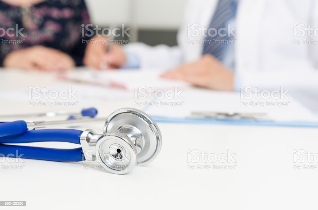Patient and doctor at the office royalty-free stock photo