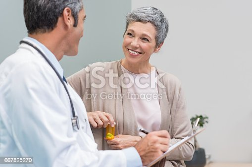 istock Patient and doctor talking 667825270