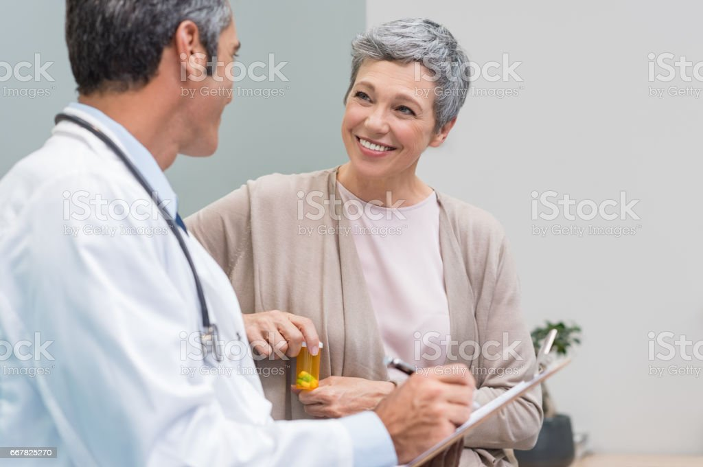 Patient and doctor talking stock photo