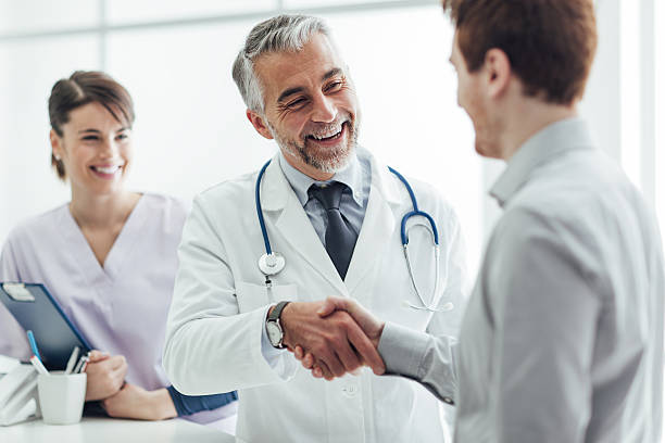 Patient and medical staff stock photo