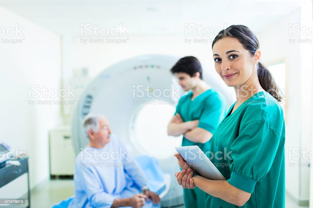 Patient and nurse in CAT scan in a hospital. stock photo