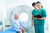 istock Patient and nurse in CAT scan in a hospital. 524512689