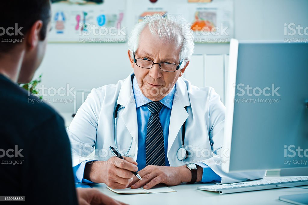 Patient and senior doctor royalty-free stock photo
