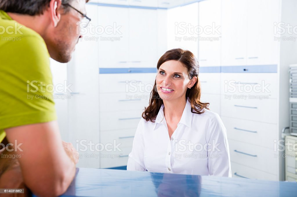 Patient at reception of doctors office stock photo