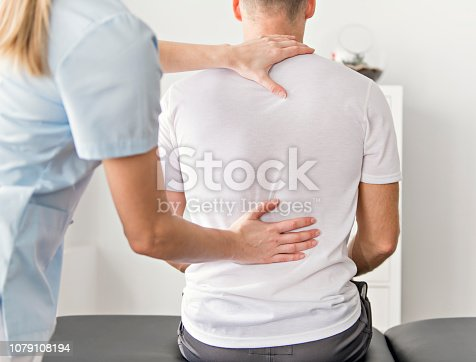 istock Patient at the physiotherapy doing physical exercises with his therapist 1079108194