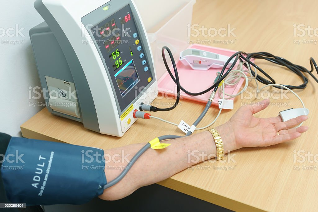 Patient being measuring blood pressure before seeing the doctor stock photo