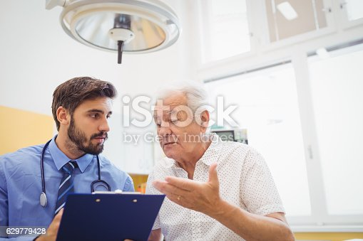 istock Patient consulting a doctor 629779428