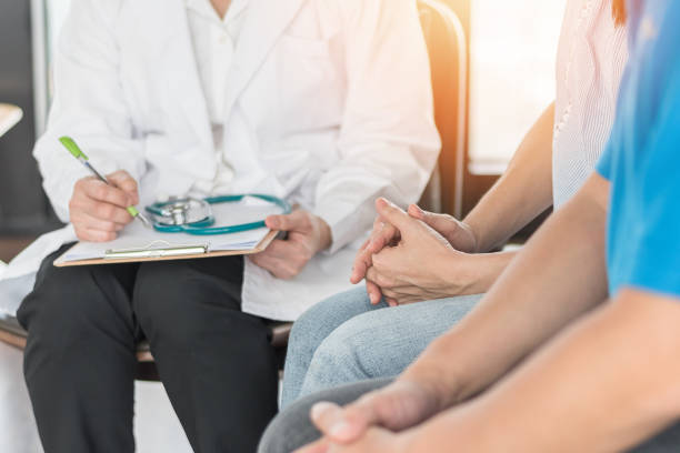 Patient couple consulting with doctor or psychologist on marriage counseling, family medical healthcare therapy, In vitro fertility IVF treatment for infertility, or psychotherapy session concept Patient couple consulting with doctor or psychologist on marriage counseling, family medical healthcare therapy, In vitro fertility IVF treatment for infertility, or psychotherapy session concept hormone stock pictures, royalty-free photos & images