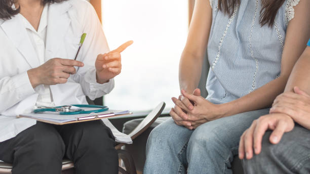 Patient couple consulting with doctor or psychologist on marriage counseling, family medical healthcare therapy, In vitro fertility IVF treatment for infertility, or psychotherapy session concept Patient couple consulting with doctor or psychologist on marriage counseling, family medical healthcare therapy, In vitro fertility IVF treatment for infertility, or psychotherapy session concept in vitro fertilization stock pictures, royalty-free photos & images