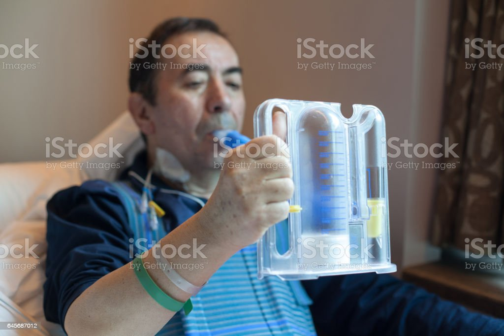 Patient doing Breathing Exercise stock photo
