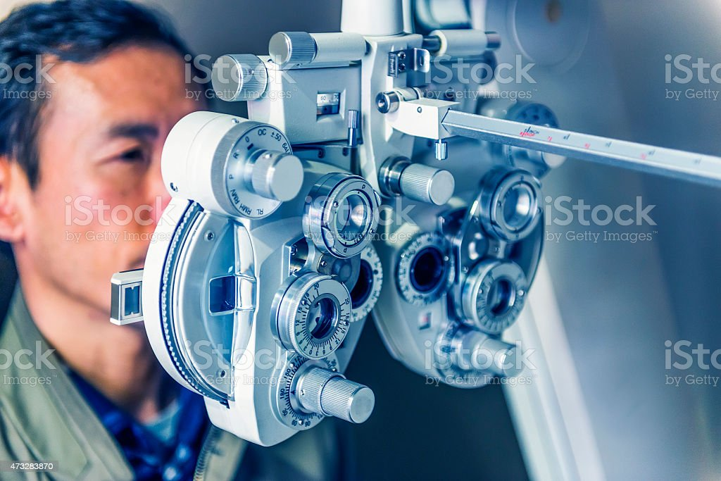 Patient during an eye test. stock photo